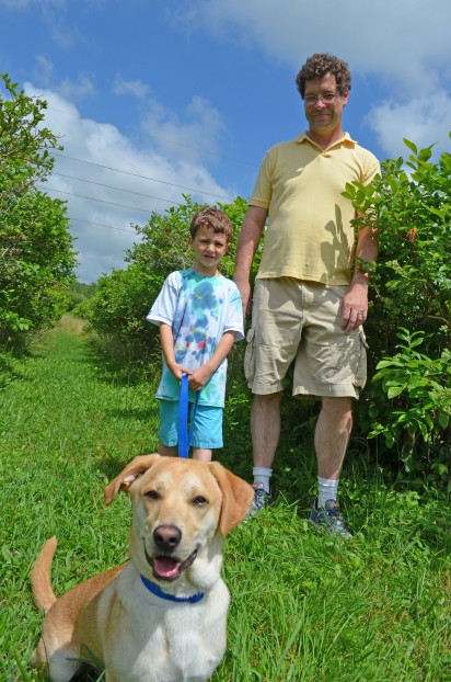 Paul Becker with son logan and dog bo