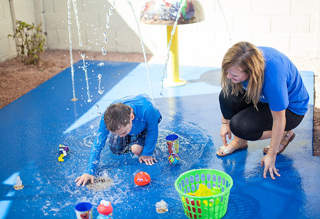 Penn State Behrend alumna Melissa Lichtinger works as online communication manager for Make-A-Wish International but also volunteers for the organization. The first wish she granted was for Lucas, who suffers from lung disease, cerebral palsy and can only communicate through non-verbal expression. A splash pad was installed in his backyard, so he would be able to play safely in water.